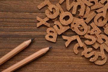 Alphabet on a wooden background