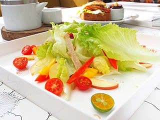Fresh and healthy salad on white plate