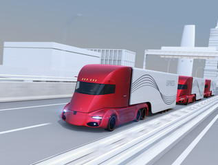 A fleet of self-driving electric semi trucks driving on highway. 3D rendering image.