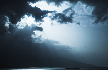 Dark stormy clouds and sunlight, landscape