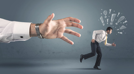 Business person getting away from a big hand