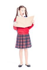 Full length portrait of Korean schoolgirl holding open notebook