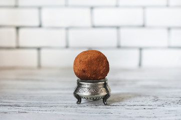 A beautiful picture of a cake. A round of potato cake one on a white brick wall background. Place and background for your text.