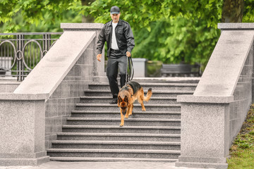 Security guard with dog on stairs