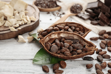Halves of cocoa pod with beans on table