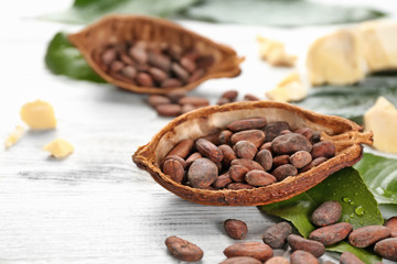 Half of cocoa pod with beans on table