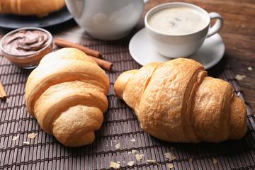 Tasty croissants on table, closeup