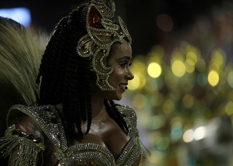 Drum queen Flavia Lyra from Imperatriz samba school performs during the second night of the Carnival parade at the Sambadrome in Rio de Janeiro