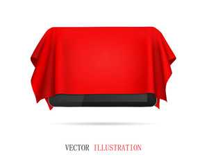 Tablet covered red cloth, presentation of new tablet, gift.