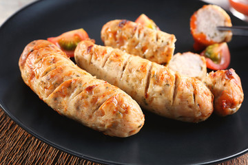 Plate with delicious grilled sausages, closeup