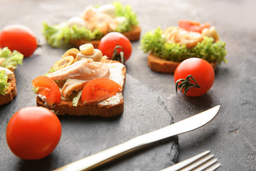 Slate plate with tasty chicken bruschetta, closeup