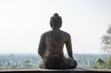 Aluminium Prints Indonesia Back of Buddha statue Borobudur temple in Yogyakarta, Java, Indonesia.