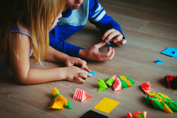 kids making origami crafts with paper