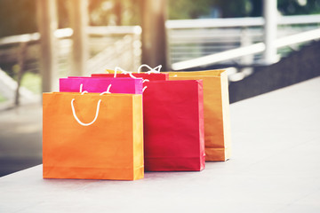 Shopping bags of women crazy shopaholic person at shopping mall. Woman love online shopping website with sales tags. E-commerce Bag Concept.
