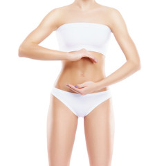 Belly of young and healthy woman. Pregnancy, diet, nutrition concept.