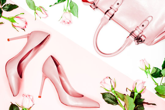 Pastel pink women high heel shoes and bag on pink background. Flat lay, top view trendy fashion feminine background. Beauty blog concept. Fashion blog look.