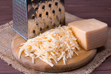 Grated cheese on a wooden cutting board