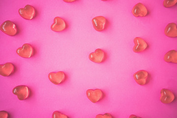 Valentines day background with heart shape candy on pink background
