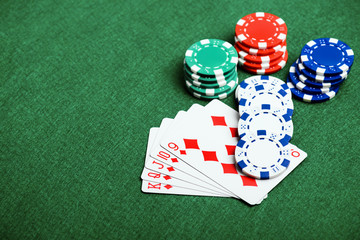 casino chips on a green felt