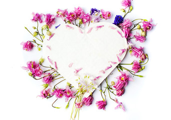 Heart shape decorated with fresh spring flowers