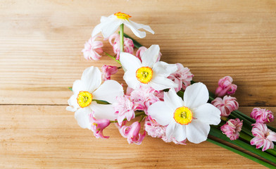 Colorful spring flowers bouquet on a wooden table