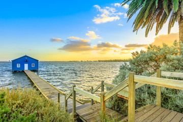 Foto op Canvas Oceanië The iconic landscape of Blue Boat House or Crawley Edge Boatshed with wooden jetty on Swan River at sunset light. One of the most photographed locations in Perth, Western Australia, near Kings Park.