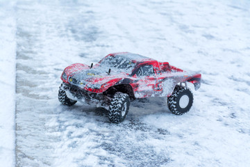 The red toy sporting car on winter rally