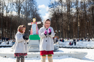 little girls dansing during Shrovetide at Russia