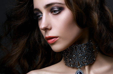 Young beautiful gothic lady with fancy stylish make-up, copy space