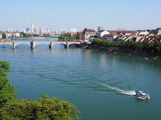 Stony Middle bridge over Rhine River in swiss Basel city center with representative historical buildings in Switzerland