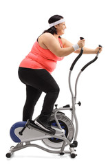 Overweight woman exercising on a cross-trainer machine