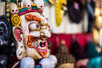 Traditional red Bhairav hindu mask hanging at souvenir market