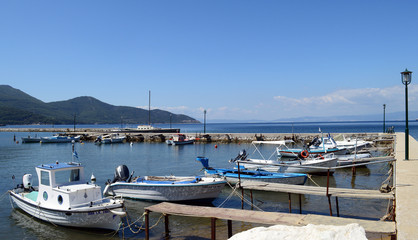 THASSOS, GREECE- September 13, 2015: Traditional Fishing boats in old Thassos harbor ( Limenas ), in Thassos island, Greece