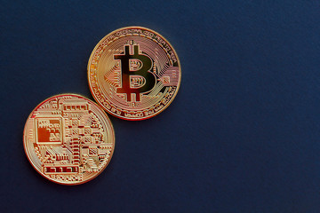 Picture of gold bitcoin over black background