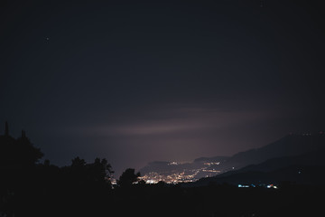 Beautiful view from the mountain on a night Monaco, flashing lights of a night city