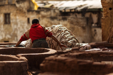 Man working hard on a tennery in Fez town of Morocco