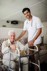 Nurse helping senior man to stand up
