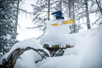 A freeride skier seen in action in fresh powder snow in the Zauchensee ski area in Austria.