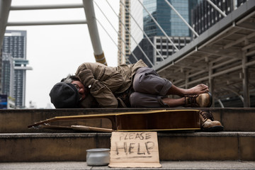 beggar or Homeless man sleep in city at winter
