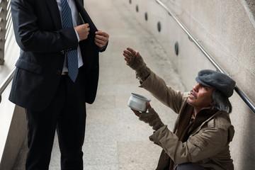 Old beggar or homeless ask for money