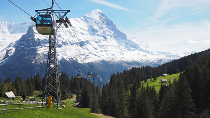 View of cable car to Grindelwald First with Alps mountains in the background, Grindelwald, Switzerland May 2017 Wall mural