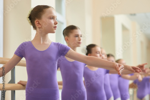0abc0752a978 Close up young ballerinas practicing ballet. Group of beautiful ...