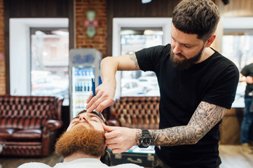 man getting trendy haircut at barber shop.