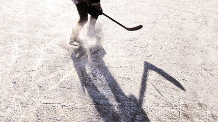Hockey player silhouette on ice, sport concept photo, white edit space