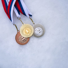 Gold silver and bronze medal - winter trophy, white edit space