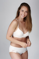 Gorgeous young woman in underwear, smiling