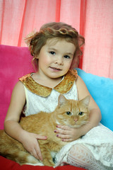 little girl with a red cat