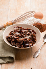 homemade cocoa tagliatelle with butter and parmesan cheese