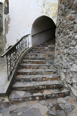 Fototapete - old stone stairs in castle