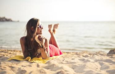 Classy girl lying on the sand